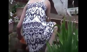 Neighbor voyeur downblouse in garden