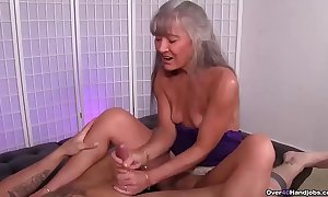 Ov40-mature wench jerking a young bloke