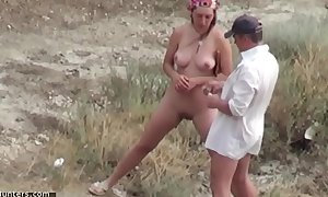 Coupler voyeured peeing on bare lido