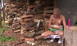 Inviting blonde girl in cute dress plays fro her coochie out of pocket