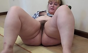 A heavy sweeping with a flimsy pussy masturbates with a cucumber