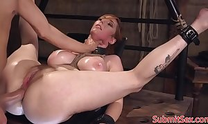 Busty redhead filial fucked into ass in s&m